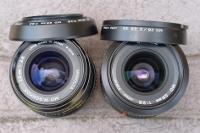 2 versions du MINOLTA MD 28 mm 1:2.8 avec leurs pare-soleil